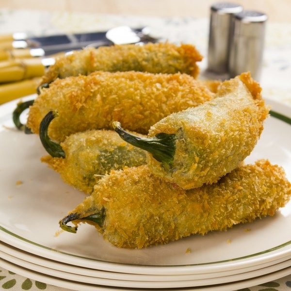Juicy jalapeno poppers breaded and filled with cheese and fried to golden perfection